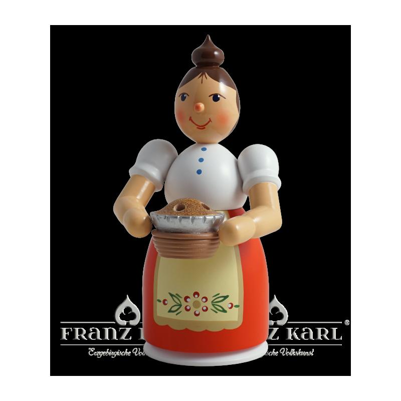 1195 Rauchfrau mit Schürze und Kuchen, farbig